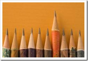 A row of pencils with one taller
