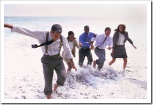 People in suits having fun on the beach