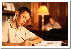 Teen boy studying