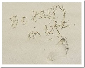 Be Happy in LIFE written in sand
