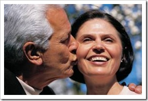 Old man kissing a woman