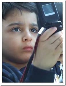 Kid on mobile phone