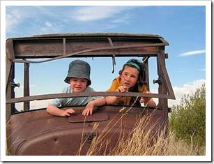 Kids playing in rusty car
