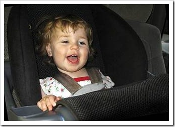 Happy kid in car seat