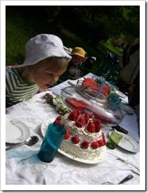Birthday kid blowing birthday candle