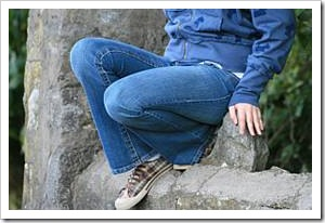 Person sitting on a rock