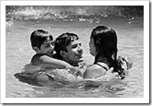 Father and kids in the pool