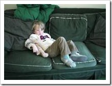 Kid slouching in front of TV