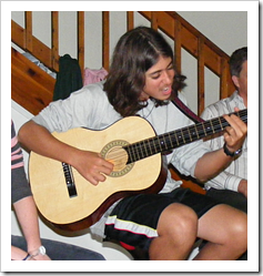 Teen playing guitar