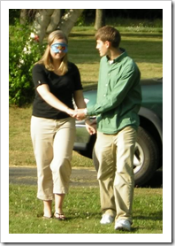 Man leading blindfolded woman