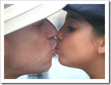 Father and daughter kissing