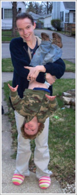 Mom holding kid upside down