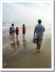 Parents and kids on beach
