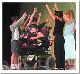Disabled boy on stage
