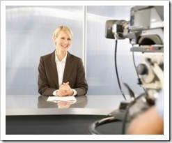 Smiling TV news anchor
