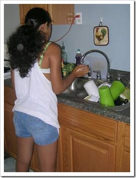 Teen washing dishes
