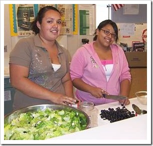 Teens making salad