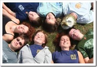 Kids lying in a circle smiling