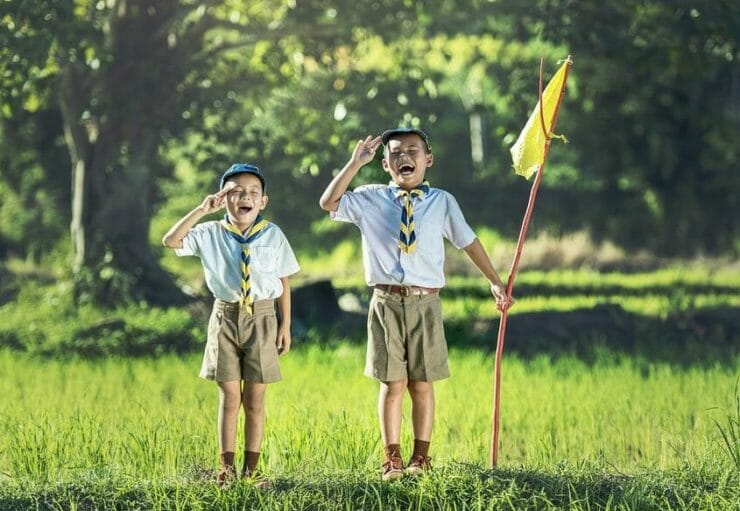 Proud scout boys with flag