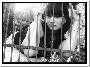 Teenage girl behind bars