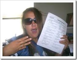 Teen girl showing exam paper