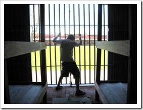 Boy locked in prison cell