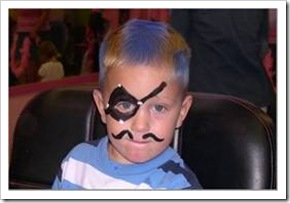 Kid in pirate costume