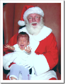 Screaming girl in Santa's lap