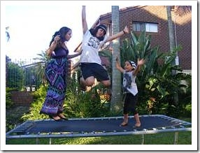 Happy kids bouncing on a trampoline