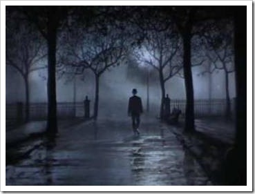 Man walking in a park at night