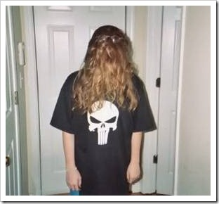 Girl with hair over face and skull on shirt