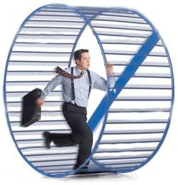 Man running in hamster wheel
