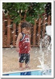 Boy in fountain