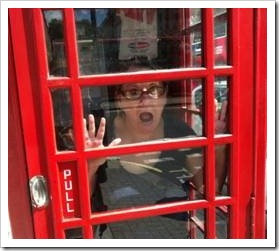Woman stuck in a phone booth