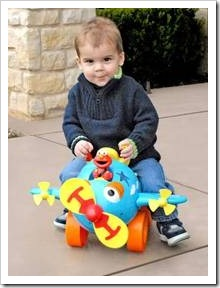 Toddler on toy plane