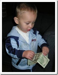 Little boy with money