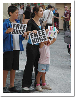 Our kids giving free hugs
