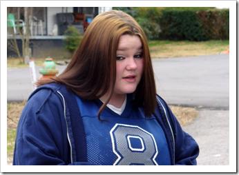 Teen girl looking defiant