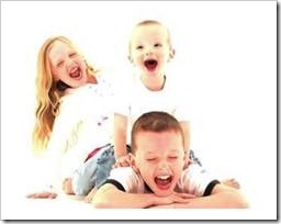 3 siblings laughing