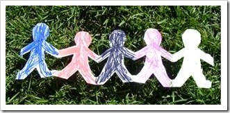 5 paper figures holding hands