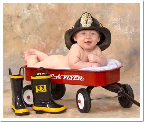 Baby boy posing nude in a fireman hat