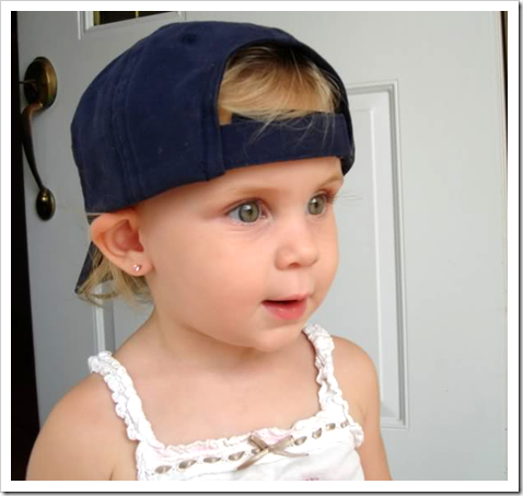 Little girl in a baseball cap