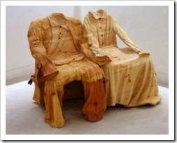 Wooden sculpture of a couple