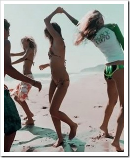 Teens dancing on the beach
