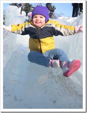 Toddler sliding on ice
