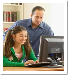 Father looking over daughter's shoulder at computer