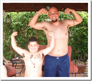 Father and son showing off their muscles