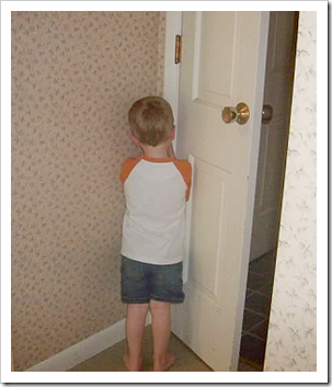 Boy facing the corner