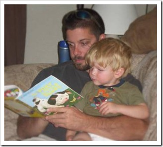 Father reading his son a story