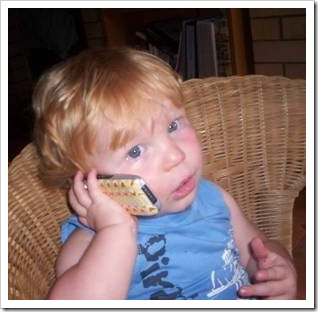 Little boy talking on a mobile phone